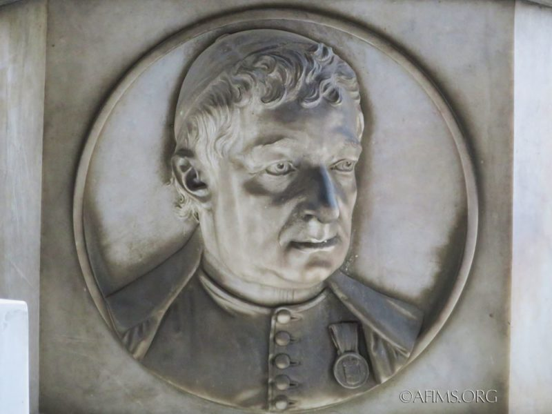 Portrait relief on the pedestal of the Maino sculpture.