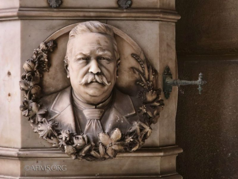 Portrait relief on the pedestal of the Marchese sculpture.
